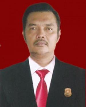 Osbal T. Sihombing